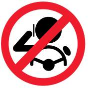 A sign instructing drivers not to use their mobiles whilst driving.